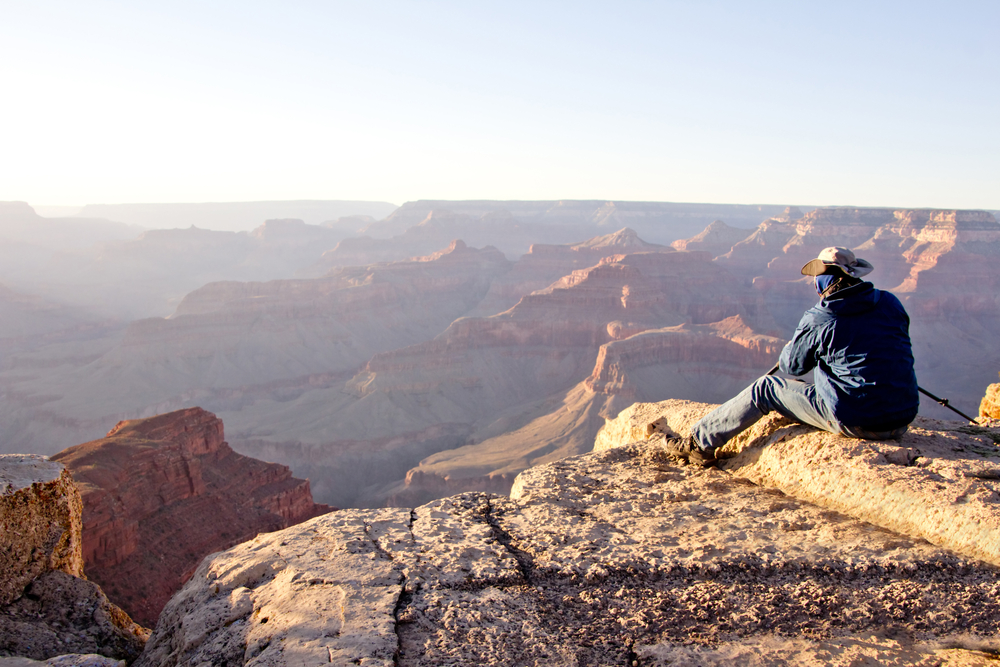 Man at the Grand Canyon looking at the great view