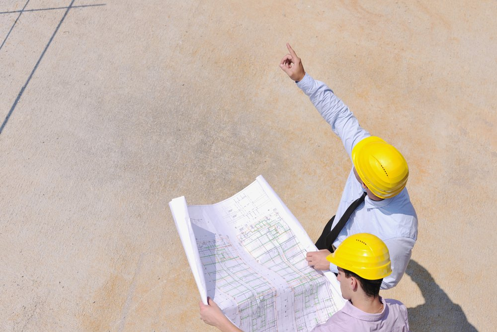 Team of business people in group, architect and engineer  on construction site check documents and business workflow on new building